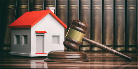 Wooden judge or auction gavel, a small house and books. 3d illustration