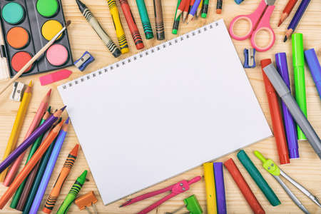 School supplies on wooden background - space for caption