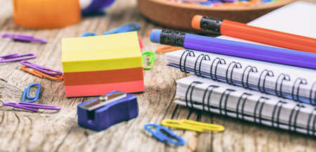 School - office supplies on wooden background