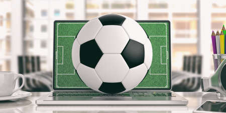 Soccer ball on a laptop - office background. 3d illustration