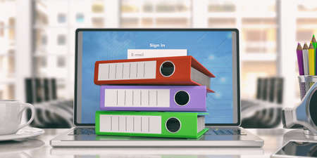 Colorful ring binders on a laptop in an office. 3d illustration