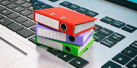 Raccoglitori ad anelli colorati su una tastiera portatile. Illustrazione 3D Archivio Fotografico