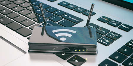 hub computer: Wifi router on a computer keyboard. 3d illustration