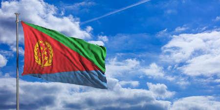 Eritrea waving flag on blue sky background. 3d illustration Stock Photo