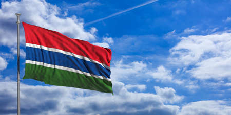 gambia: Gambia waving flag on blue sky background. 3d illustration