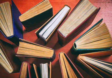 Old books on wooden background - top view Reklamní fotografie - 82428228