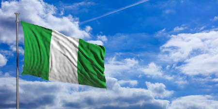 Nigeria waving flag on blue sky background. 3d illustration Stock Photo
