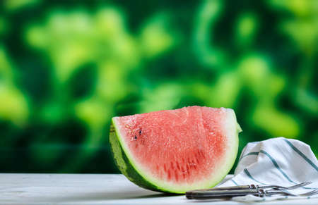 sliced watermelon: Ripe watermelon slice on a wooden table - copy space Stock Photo