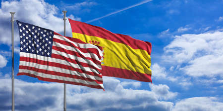 USA and Spain waving flags on blue sky background . 3d illustration Stock Photo