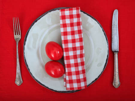 Easter eggs on a plate on red background