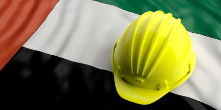 Yellow construction hat over UAE  flag. 3d illustration