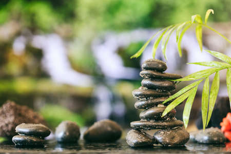 Zen stones stacked on abstract nature background Stock Photo