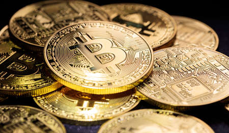 Cryptocurrency concept. Golden shining bitcoins background Фото со стока