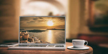 Laptop with Santorini island screen and silver color placed on a wooden table. Blurred coffee shop background. 3d illustration Stock Photo