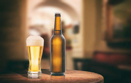 brewery: Unopened beer bottle on a wooden table, abstract bar background. 3d illustration Stock Photo