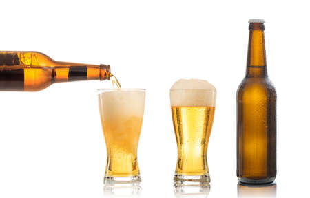 Bottles and glasses of beer on white background. Pouring beer into one glass