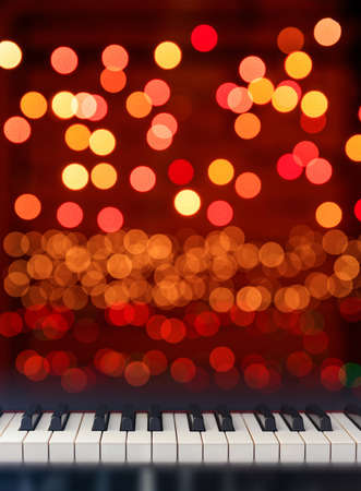Classical Piano keyboard front view on Christmas lights bokeh background Stock Photo