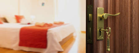 Hotel doorway with half opened door, blur bedroom background. 3d illustration 免版税图像