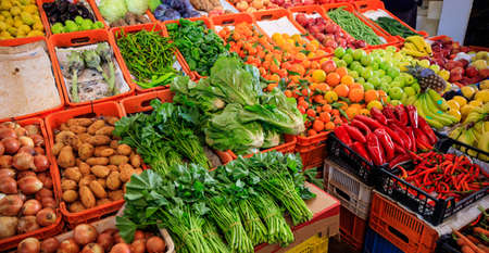 Variety of fresh vegetables and fruits for sale in a market in Nicosia Cyprus. Closeup view with details. 스톡 콘텐츠