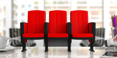 Red theater chairs on blurred office background, front view. 3d illustration Stock Photo