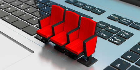Live streaming video watching concept. Red theater chairs on computer keyboar. 3d illustration Stok Fotoğraf