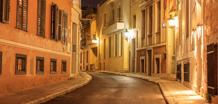 Plaka, Athens, traditional buildings at the sides of an illuminated street. Architecture in Greece. Reklamní fotografie