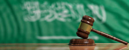 Judge or auction gavel on Saudi Arabia waving flag background. 3d illustration