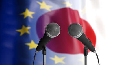 Relationship between European Union and Japan. Two cable microphones in front of blurred flags for backdrop. 3d illustration