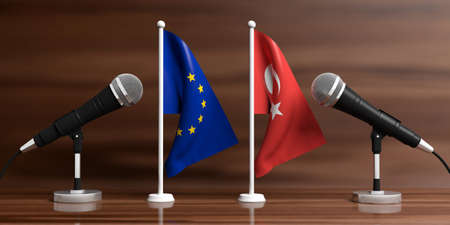 Relationship between European Union and Turkey. Cable microphones on stands on a wooden background, banner. 3d illustration Stock Photo