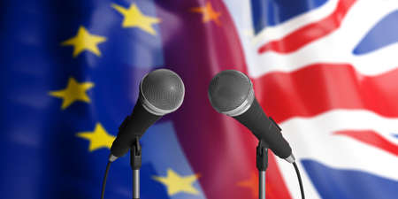 Relationship between European Union and England. Two cable microphones in front of blurred flags for backdrop. 3d illustration 写真素材