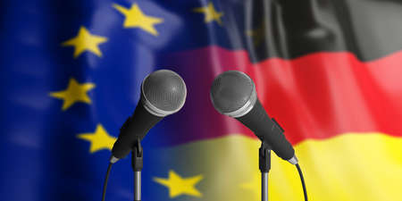 Relationship between European Union and Germany. Two cable microphones in front of blurred flags for backdrop. 3d illustration