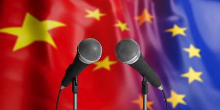 Relationship between European Union and China. Two cable microphones in front of blurred flags for backdrop. 3d illustration