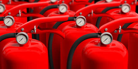 Fire safety. Group of red fire extinguishers, closeup view. blur background. 3d illustration Stock Photo