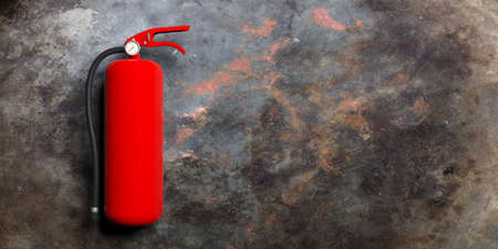 Fire safety, Red fire extinguisher isolated on metal rusty background. 3d illustration Stock Photo