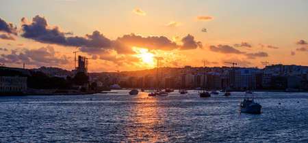 Malta Valletta. Modern Sliema panoramic view, sea and sky background at sunset