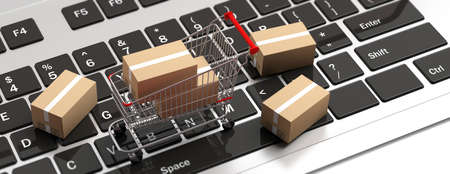 Online shopping. Boxes closed and a shopping cart on computer laptop. 3d illustration Stock Photo