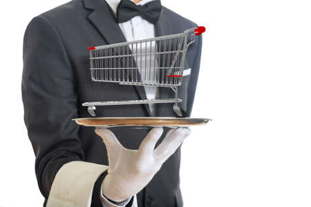 Shopping luxury service concept. Waiter holding a silver platter with an empty shopping cart, on white background. 3d illustration