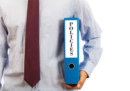 Business policies. Manager holding a binder folder on white background, text policies, clipping path 写真素材 - 104514413
