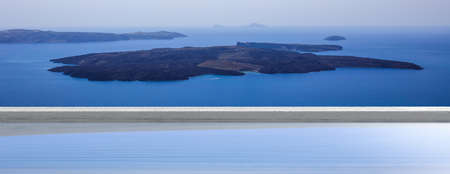Luxury summer vacation in Greek islands, Santorini, Greece. View to volcano over a swimming pool, banner Stock Photo