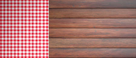 Red and white checkered picnic tablecloth on wooden table, copy space. 3d illustration