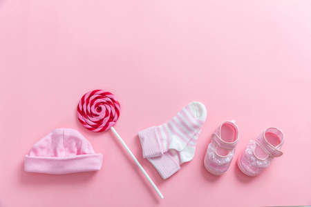 Baby girl shower concept on pink background, top view, copy space Stock Photo