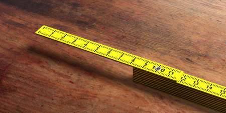 Carpenter folding ruler. Yellow wooden meter isolated on wooden background, copy space. 3d illustration