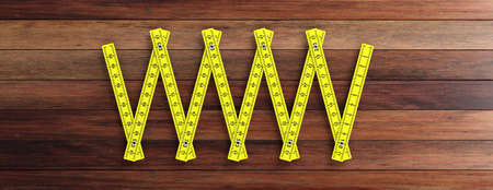 Carpenter folding ruler. Yellow wooden meter isolated cutout on wooden background, banner. 3d illustration