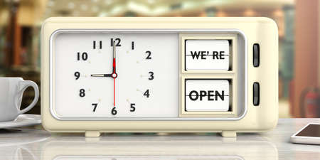 29e287e25ac5be we are open text on retro vintage alarm clock on a white desk against blurry  shop