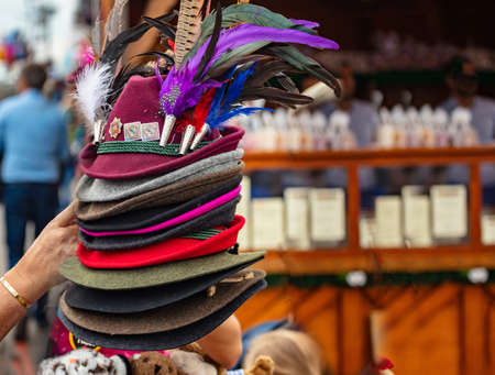 Stack of traditional tyrolean hats with feathers, Oktoberfest, Munich, Bavaria