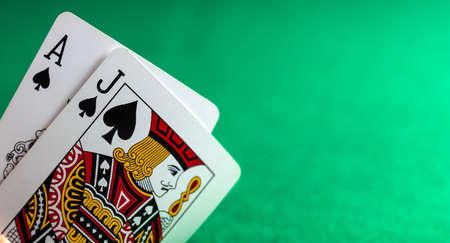 Casino, poker, gambling concept. Blackjack on green felt background, copy space