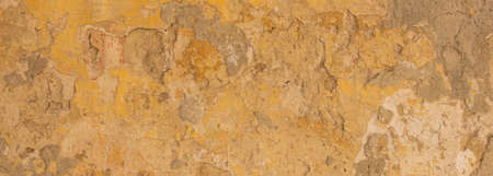 Beige yellow color, painted and faded wall texture grunge background, banner