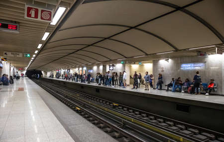 April 14, 2019. Greece, Athens. Metro station at the city center. Passengers at the platforms waiting for the trains to come Editoriali