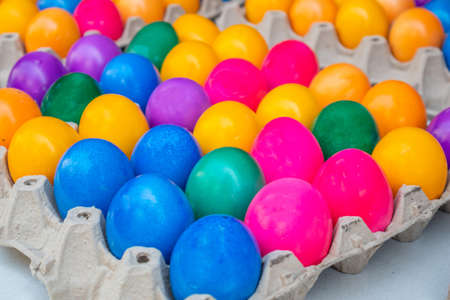 Orthodox Easter. Colorful eggs in carton packaging, close up view, full background