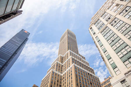 New York, Manhattan commercial center. Skyscrapers perspective view against blue sky background, low angle view